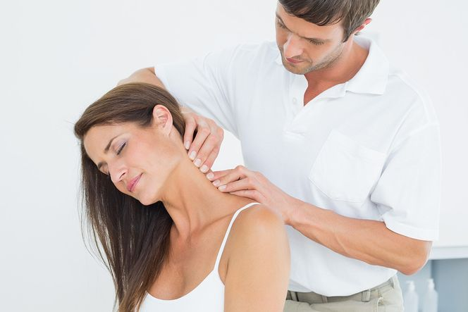 Chiropractor treating a patient